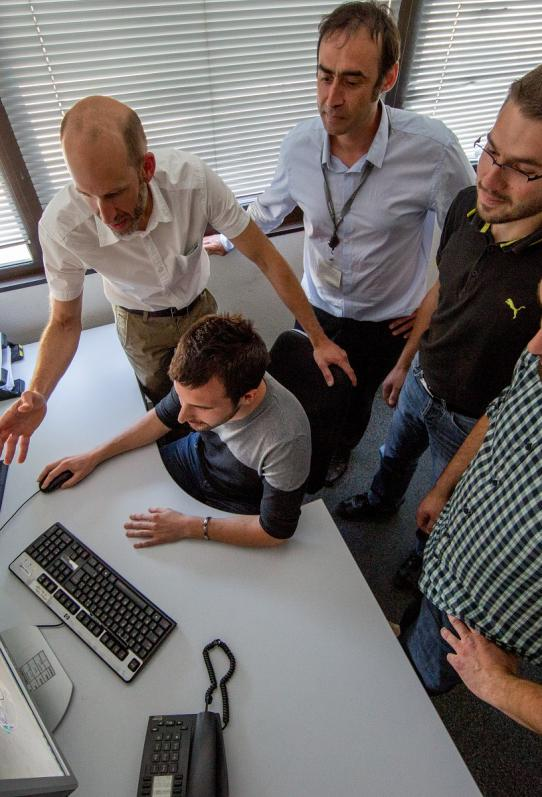 Engineers working on the eCentric software