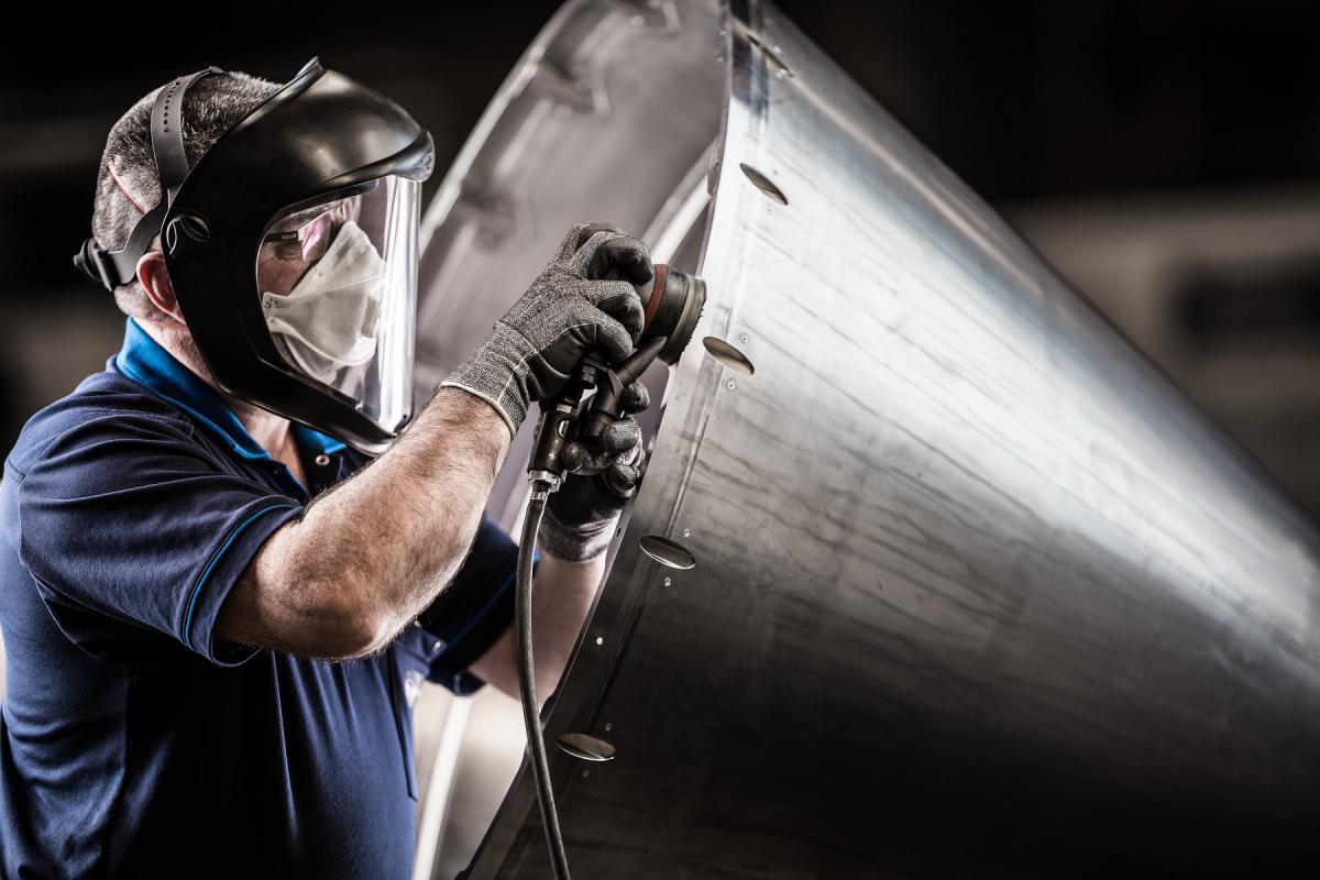 Nozzle Center - Drilling and sanding of A380 titanium nozzle