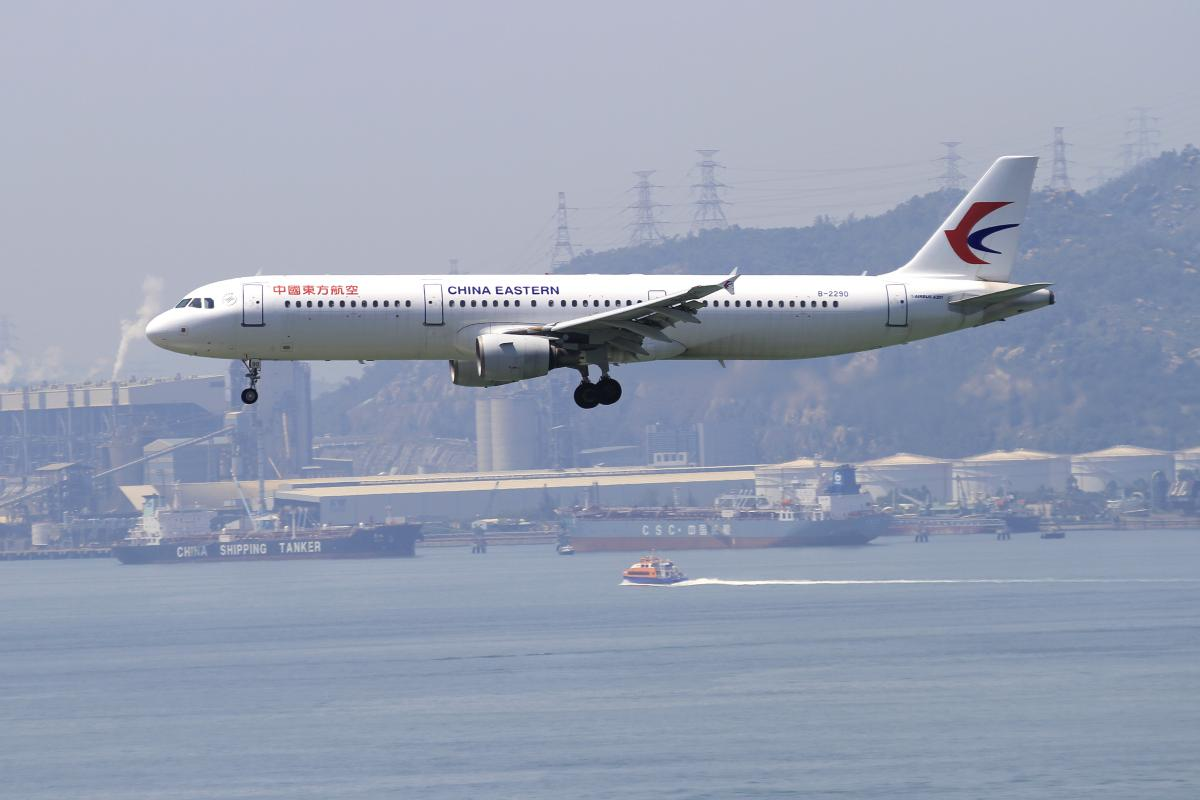 China Eastern Airbus A321 on final approach at low altitude landing at Hong Kong International Airport
