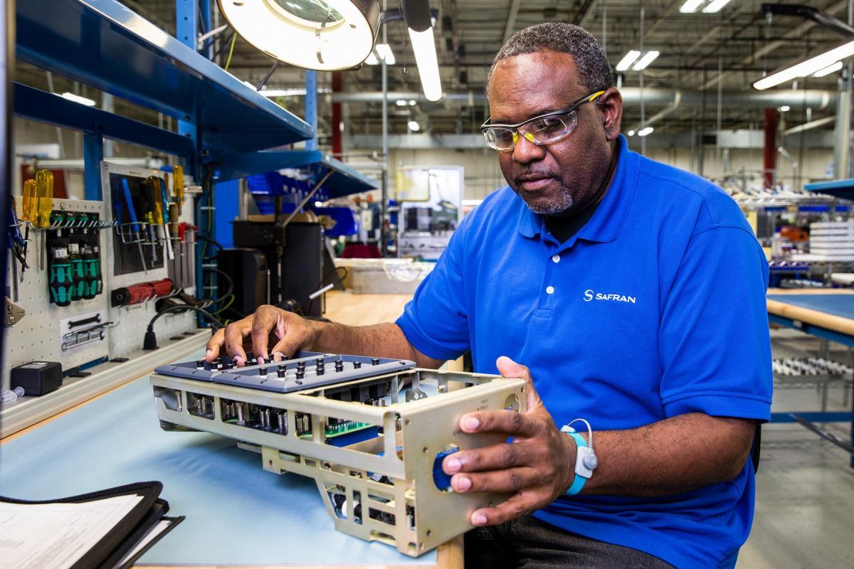 Employee working on circuit breaker panel