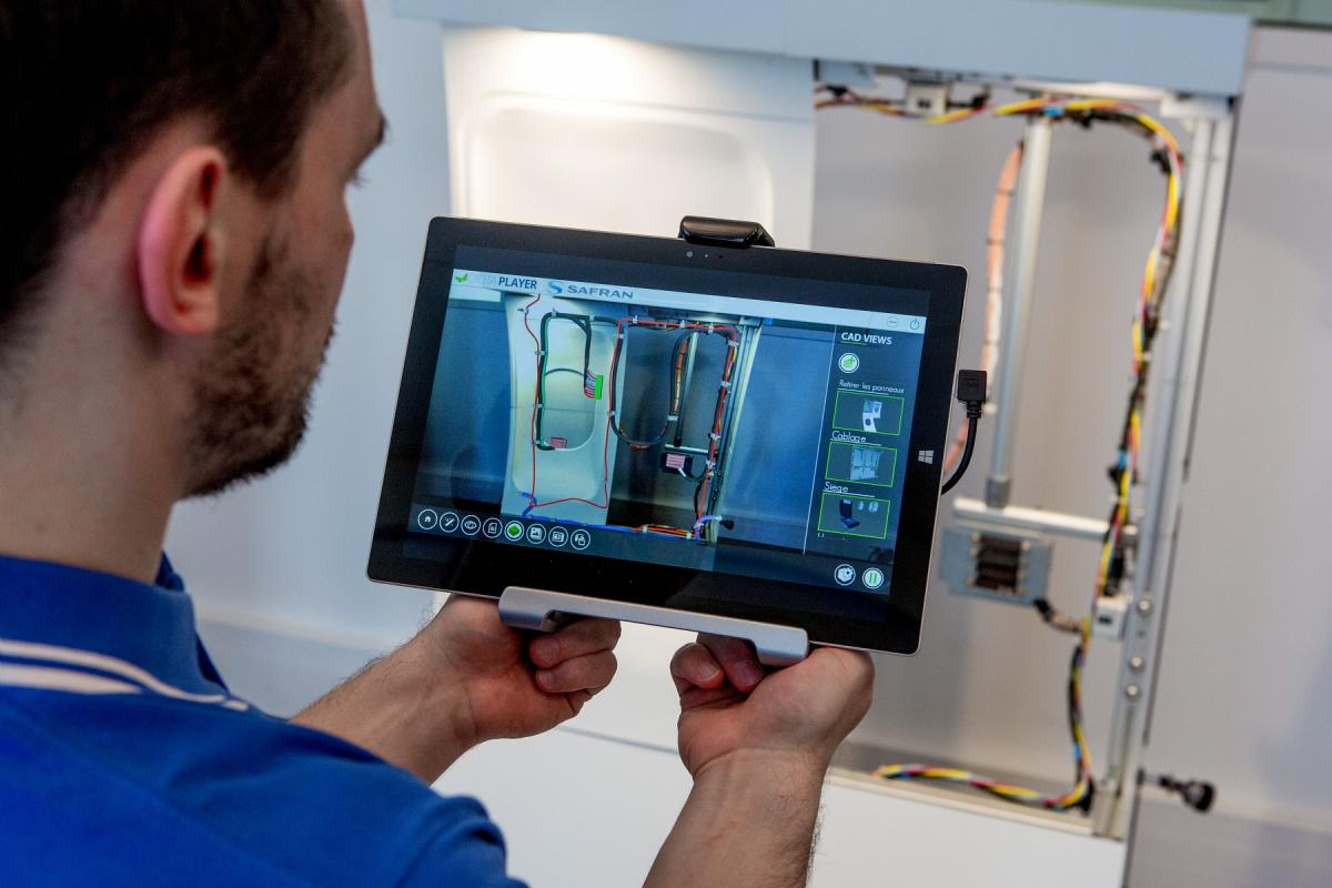 Repair of wiring in an aircraft with augmented reality.